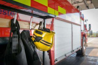 Firefighters gear hanging off fire truck