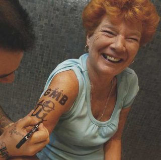Mary Turner getting tattoo